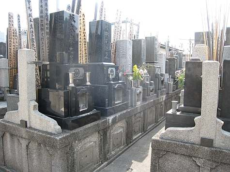 a typical cramped Japanese cemetary