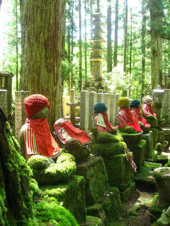 Jizo in cemetary with hat and bib